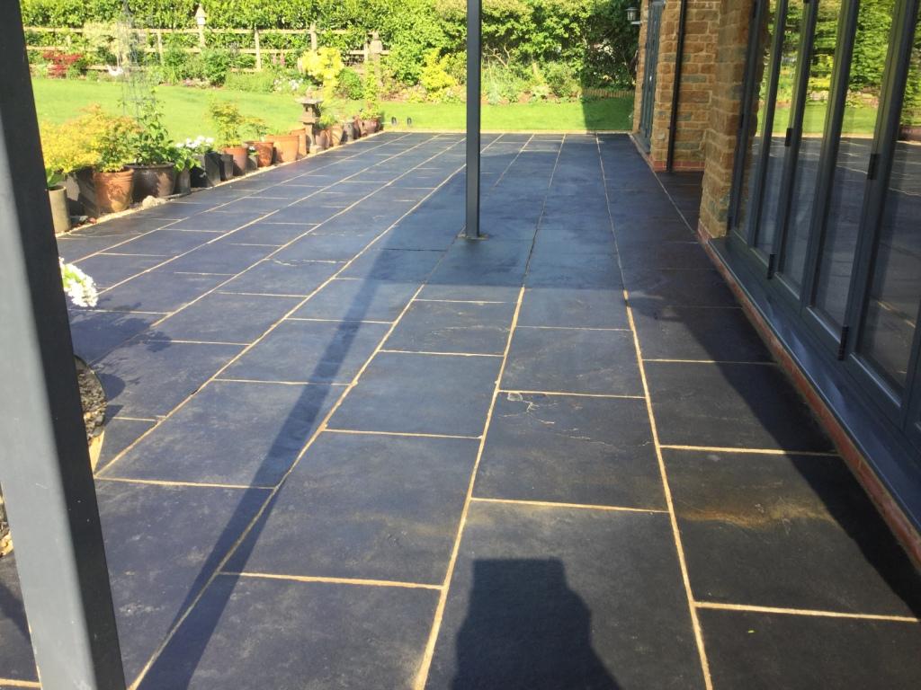 Black Limestone Patio Renovated In Northamptonshire